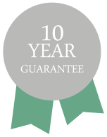 A rosette that says 10 year guarantee