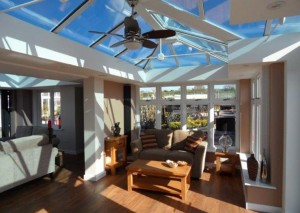 An orangery with sun shining through the glass roof