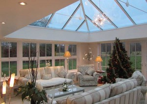 An orangery decorated for Christmas with warm lighting