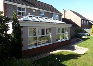 A large orangery leading onto patio and garden