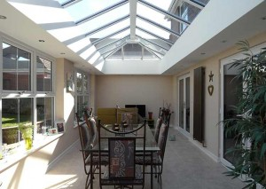 An orangery used as a dining room with tiled floor
