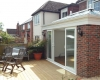 An orangery with sliding patio doors that open onto the decking