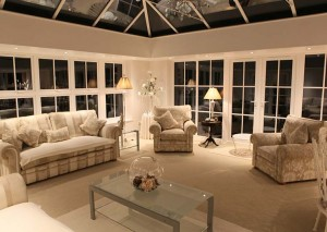 Warmly lit orangery with luxurious furnishing
