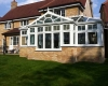 A grand combination conservatory in white uPVC