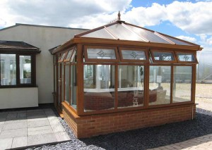 an oak colour Edwardian style conservatory