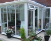A small gull-wing conservatory in white