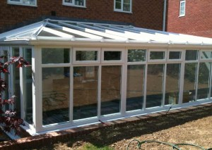 A large gull wing conservatory in white