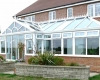 A large white uPVC conservatory with bespoke layout