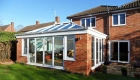 Large orangery sitting between garden and patio area