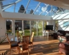 An internal view of an orangery with the sunlight beaming through
