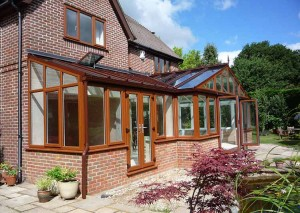 An oak coloured uPVC combination conservatory