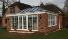 An orangery with glazed roofs and windows