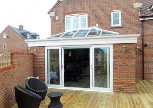 An orangery with large sliding doors