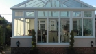 A large Regency conservatory leading onto decking
