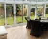 White sliding patio doors leading onto the garden - conservatory door