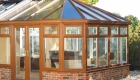 An oak coloured Victorian conservatory