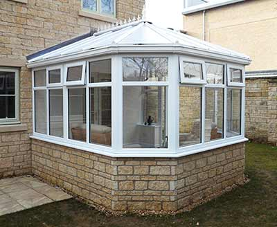 Victorian conservatory in white with brick base