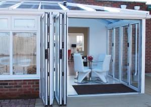 White bi-folding doors open fully