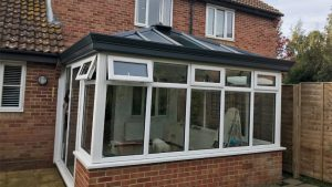 White upvc conservatory with dwarf brick walls
