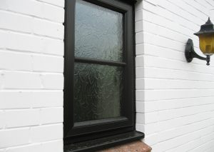 Black ash uPVC window with astragal bars